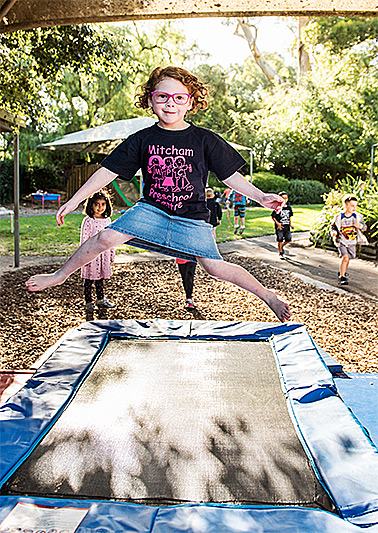 Girl Jumping on a trampolin